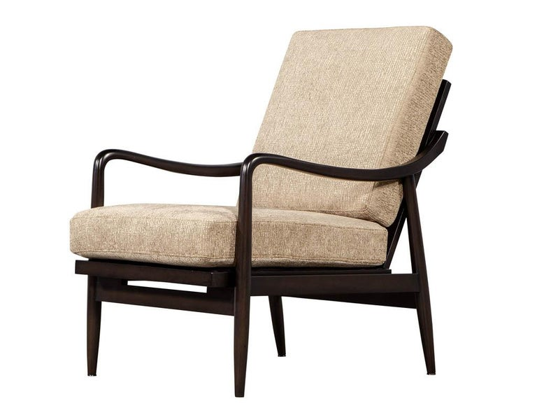 Vintage Mid-Century Modern lounge chair. Newly refinished and reupholstered by our artisans. Featuring sleek curved walnut frame and textured beige designer fabric.