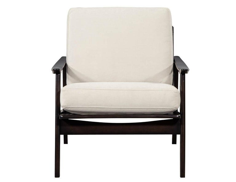 Vintage Mid-Century Modern lounge chair. Fully restored in a hand rubbed ebony finish and reupholstered in a designer velvet covering.  Price includes complimentary scheduled curb side delivery service to the continental USA.