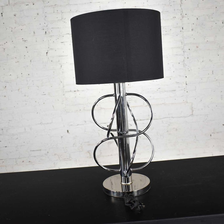Striking vintageMid-Century Modern polished chrome table lamp with new black Fenchel drum shade. Wonderful condition although there is a tiny ding in the shaft and age-appropriate wear as you would expect with a vintage piece. Please see photos.