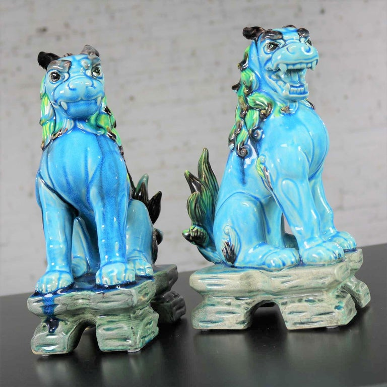 Awesome pair of vintage midcentury Japanese Komainu or Lion Dogs in ceramic with a gorgeous glaze that is primarily turquoise green but mixed with many other wonderful colors of greens and blues and blacks and browns. They are in fabulous vintage
