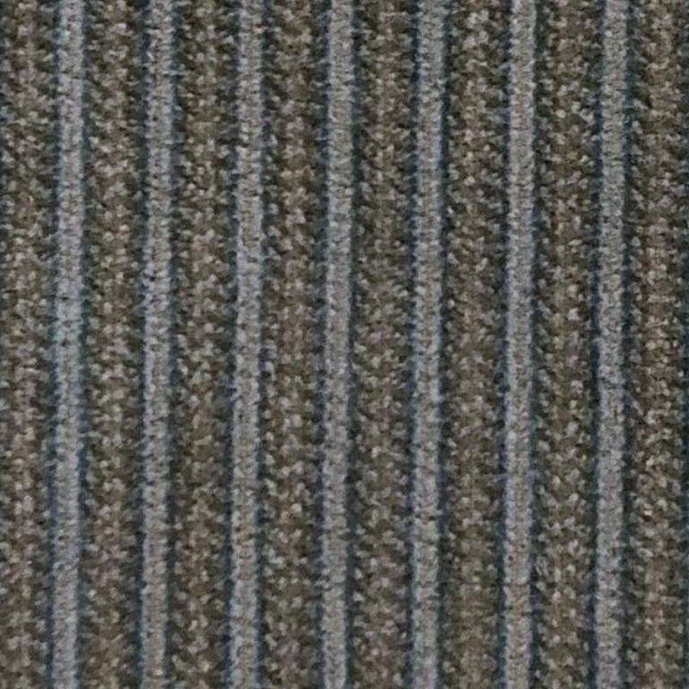 This vintage 100% cotton corduroy features light green patterned cords with a light blue trim in a two-cord pattern that is half an in wide. The manufacturer is unknown.   This fabric could be used to make clothing and upholstery products.