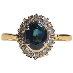 Vintage Midcentury 1 Carat Sapphire Diamond Halo 18 Karat Gold Engagement Ring