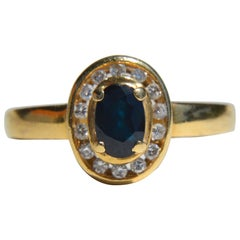 Vintage Midcentury .35 Carat Sapphire Diamond Halo 14 Karat Gold Engagement Ring