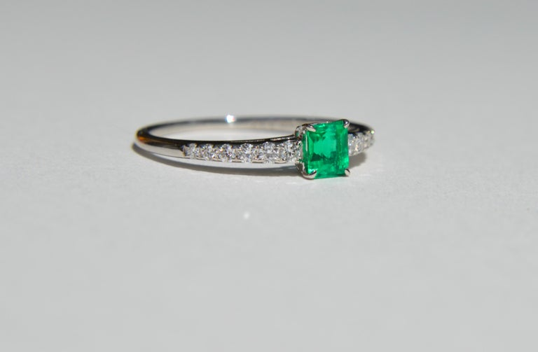 Gorgeous vintage circa 1960s Midcentury era .45 carat emerald cut natural Colombian emerald and diamond ring in solid platinum. In very good condition, shows no signs of wear. Size 7.25. The saturated rich Kelly green emerald had very little