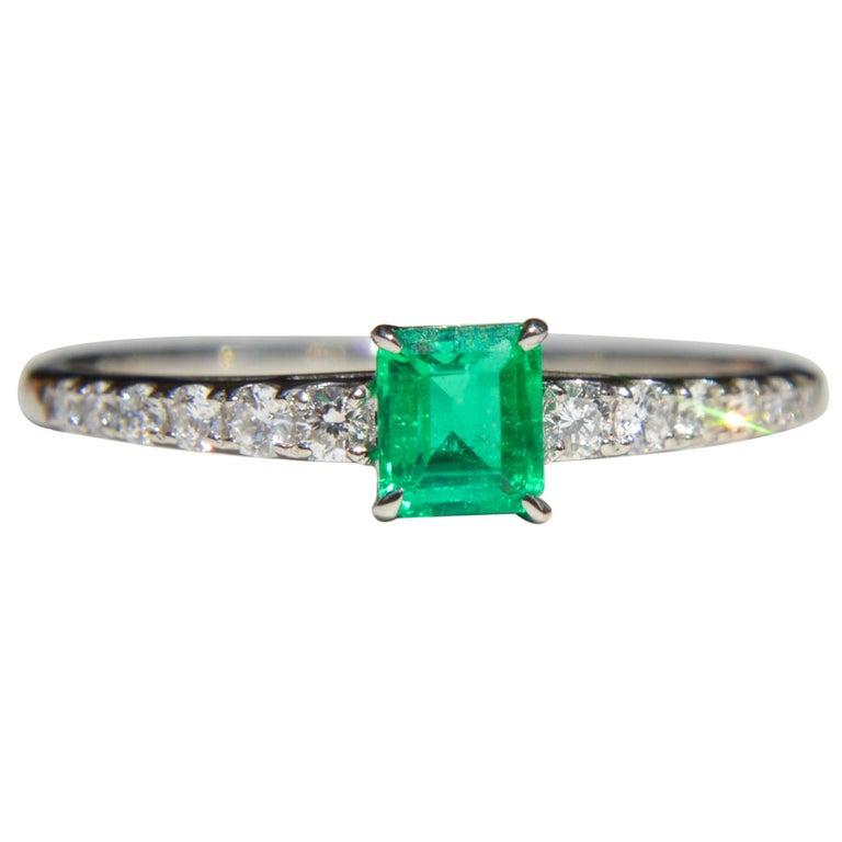 Vintage Midcentury .45 Carat Colombian Emerald Diamond Platinum Ring For Sale