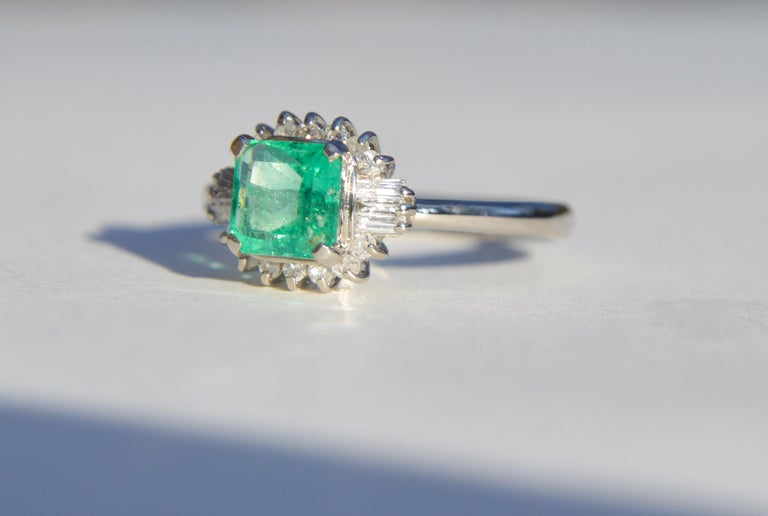Beautiful vintage circa 1950s midcentury era .71 carat princess cut Colombian emerald ring with single cut round and baguette diamond halo in solid platinum. Ring is marked as PT900 for platinum. Size 6.25, can be resized by a jeweler. Emerald