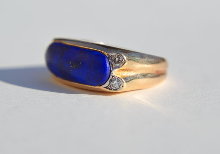 Gorgeous vintage circa 1960s lapis lazuli 14K yellow gold ring with diamonds. Size 5.75 can be resized by a jeweler, in good condition, slight wear to the lapis. 4 single cut diamonds each 2mm in diameter (.03 carat each). Lapis east west cabochon