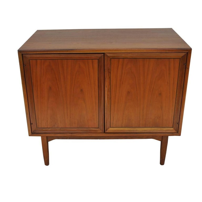 Kipp Stewart for Drexel walnut record cabinet    Beautiful Kipp Stewart for Drexel Declaration record cabinet, circa 1960s. Walnut with two spring action release cabinet doors. One side has original record slots and also features an overhead