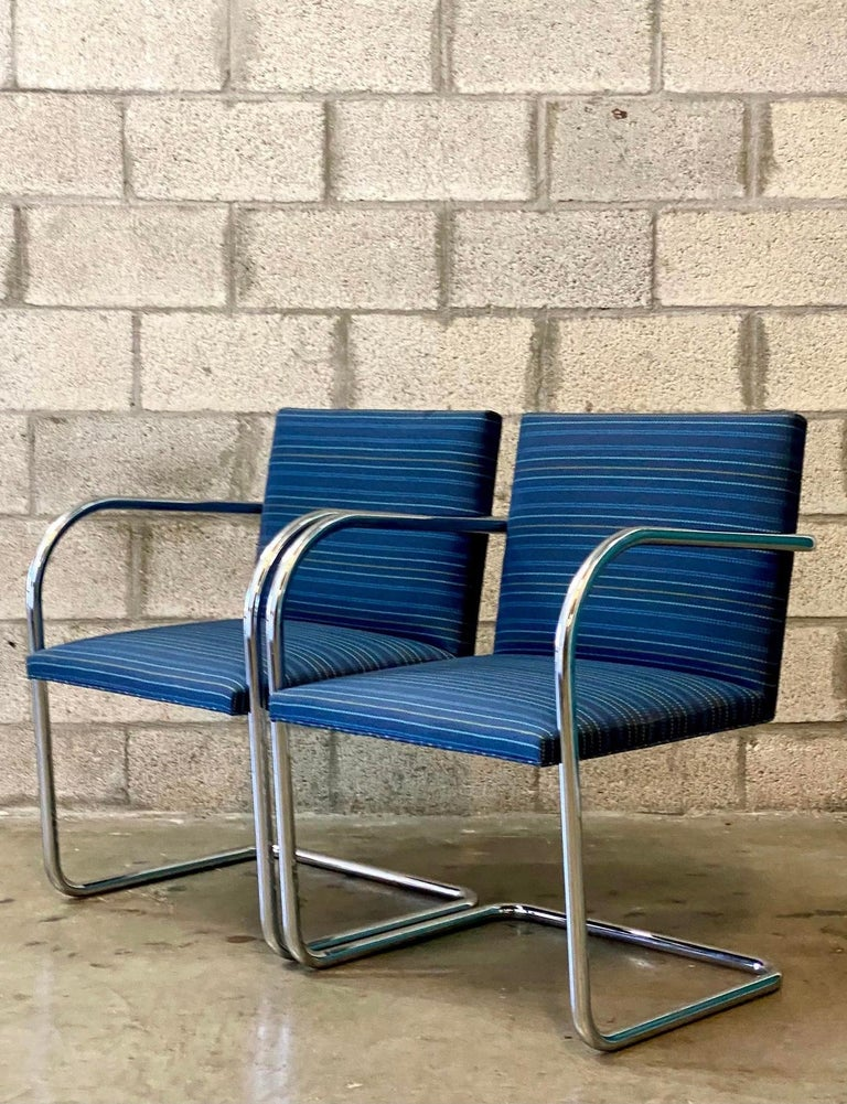 Iconic pair of MCM Knoll chairs. The tubular version of the coveted BRNO design. A cantilevered profile with brilliant blue broken stripe upholstery.