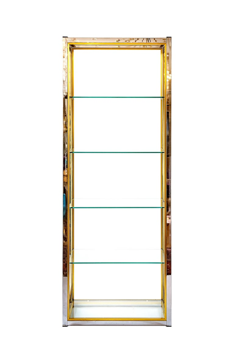 Vintage midcentury pair of shelves by italian designer Renato Zevi, circa 1970. Perfect condition of chrome surface and brass details and five transparent glass shelves.
