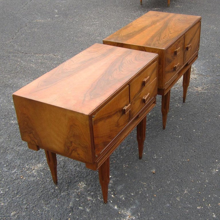 Vintage midcenturyrosewood side tables nightstands Beautifully grained rosewood with wood pulls.  2 drawers with cabinet for ample storage and unique tapered legs.