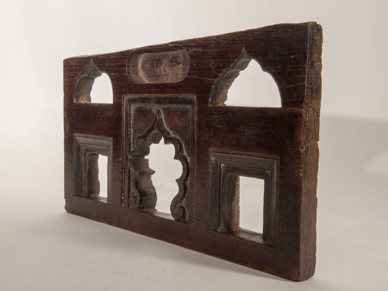 Vintage miniature architectural votive and picture frame, mid-20th century, India. This vintage hand-carved wooden frame, from South India, was used to hold a small statue or picture of a Hindu Diety, very often a Garuda. It would have been placed