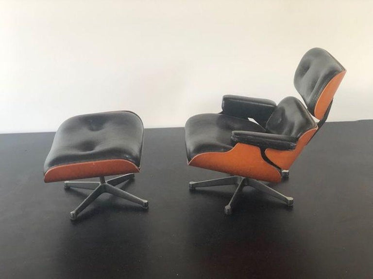 Vintage Miniature of Charles Eames, Ray Eames - Vitra Design Museum - 670 lounge chair and 671 ottoman  The Vitra Design Museum has been producing miniature replicas of furniture design milestones from its collection for over two decades. The