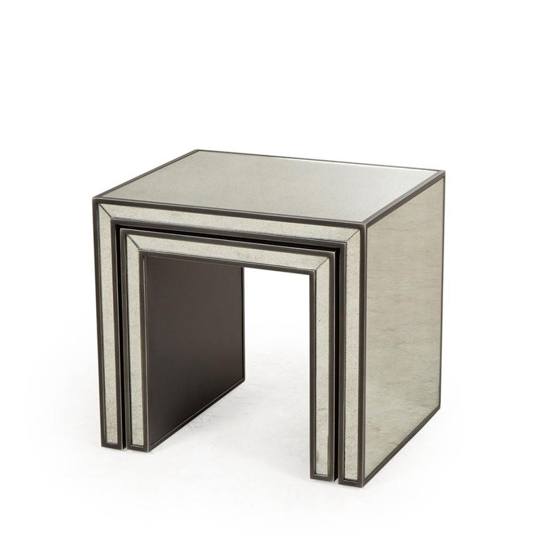 Side table vintage mirrored set of 2 with structure in solid acacia wood. All covered with mirrored glass in vintage finish. With steel frame trim.