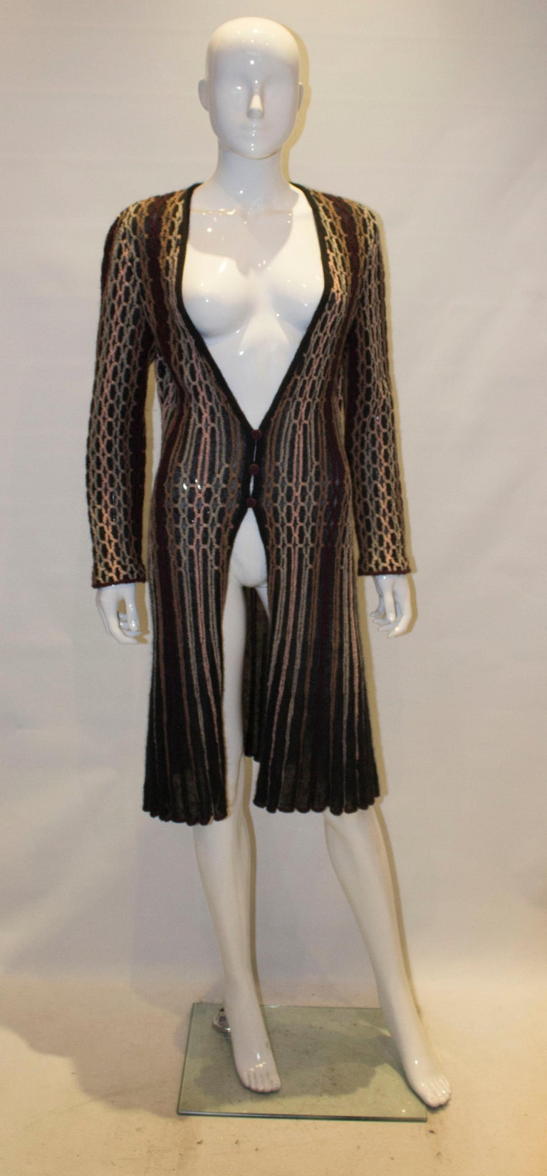 A vintage Missoni Brown Label Cardigan /Jacket . The jacket has a black background with multicolour stripes, a v neckline and a three button front opening.