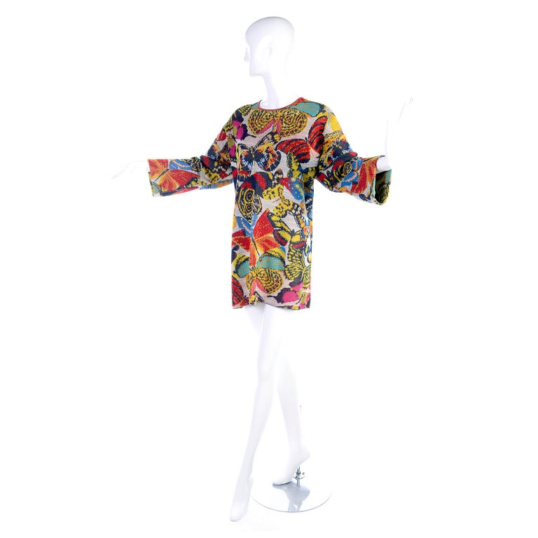 This wonderful vintage Missoni sweater is in a linen, rayon, cotton and nylon blend knit fabric in a multi color butterfly print.  You can wear this as an oversized sweater or mini dress, depending on your height. and it is labeled Missoni For Saks