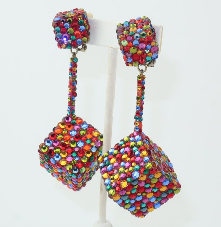 Fun, flirty, festive and fabulous!  These large clip on C.1970 earrings are fabricated from dangling cubes fully embellished with multi-color pave crystals in shades of red, green, yellow, blue and orange.  Even the spacers attaching the dangles are