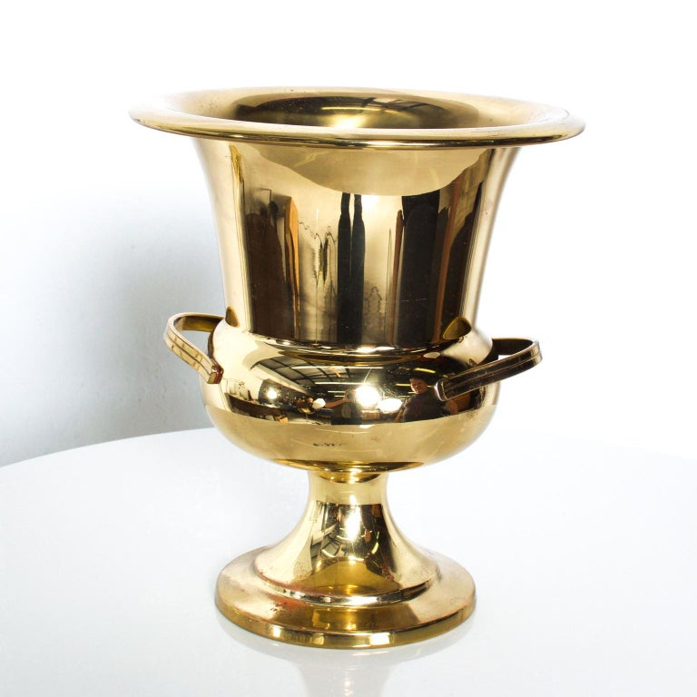 For your consideration: an Elegant Vintage Midcentury Hollywood Modern Brass Plated Gold Champagne Wine Bucket Holder. It dates from the 1960s. Attributed to Tommi Parzinger.  Dimensions are: 8 5/8