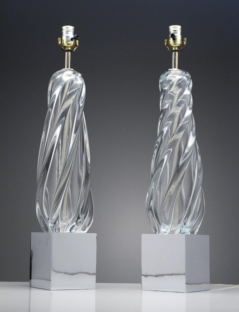 Wonderful pair of vintage clear glass and chrome table lamps. The lamps date back to the 1970s. Lamps measure 27