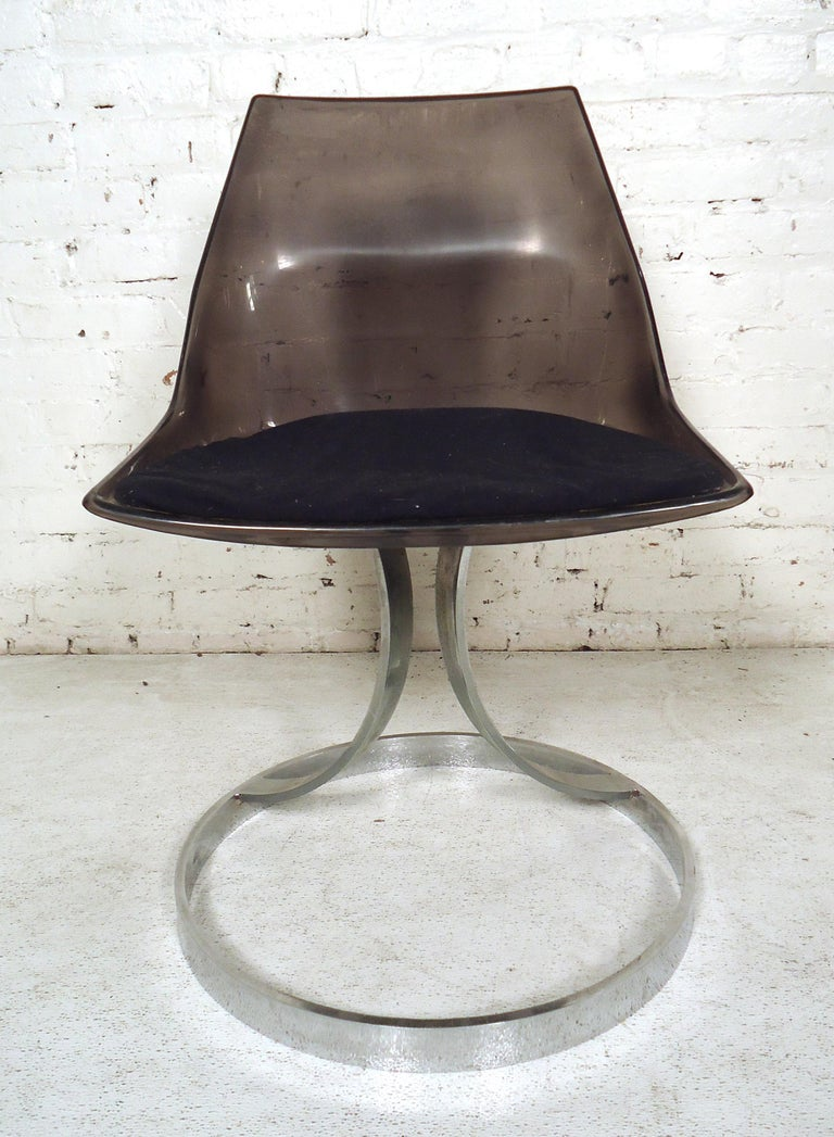 Italian Mid-Century Modern style Lucite chair featuring chrome legs and upholstered cushion.