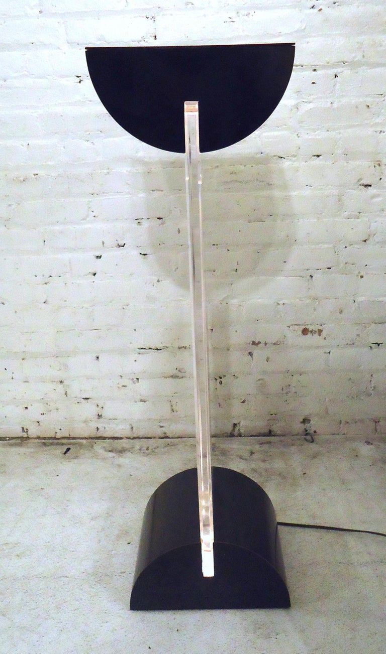 Mid-Century Modern pedestal stand features an illuminated Lucite body.