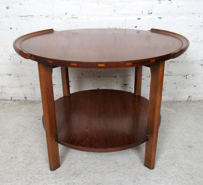 Mid-Century Modern round two-tier side table by Lane featured in rich walnut grain.  Please confirm item location with dealer (NJ or NY).