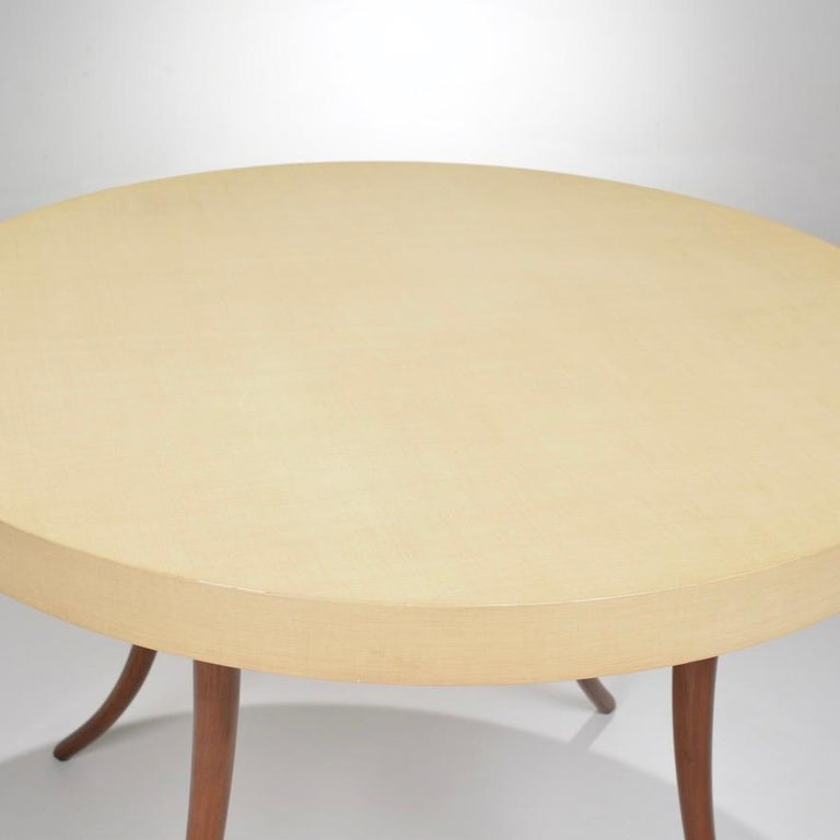 Vintage modern round table with a Formica top and teak base.