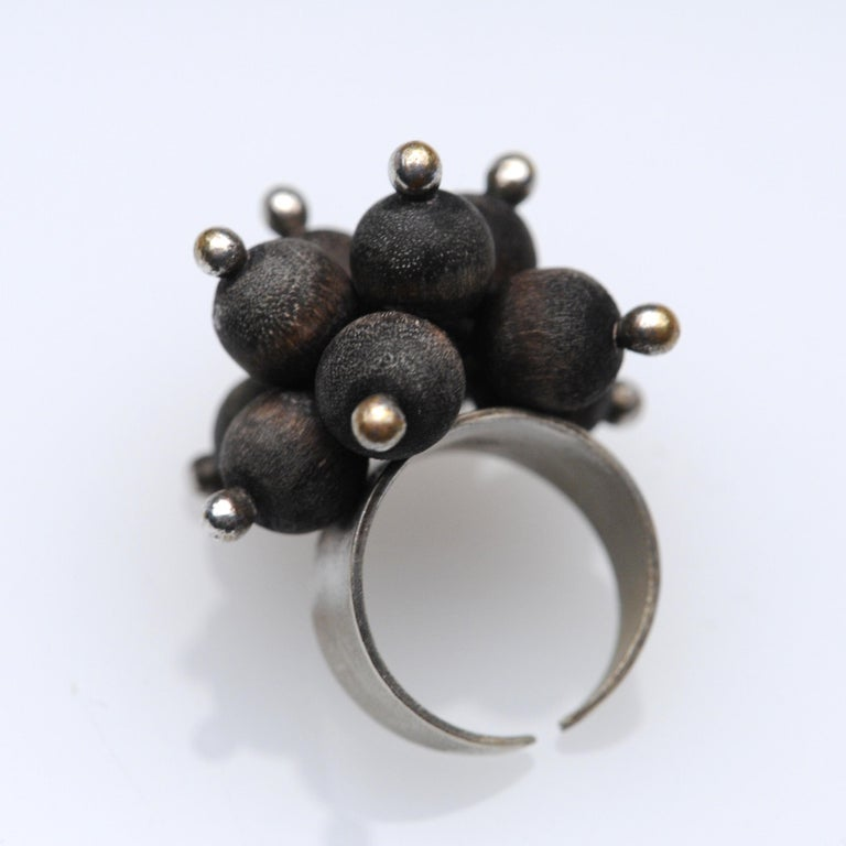 Beautiful and sculptural ring by Kaija Aarikka of Finland from the 1970s. Ring is made from silver and wood. Currently it is a size 6 but it is adjustable.