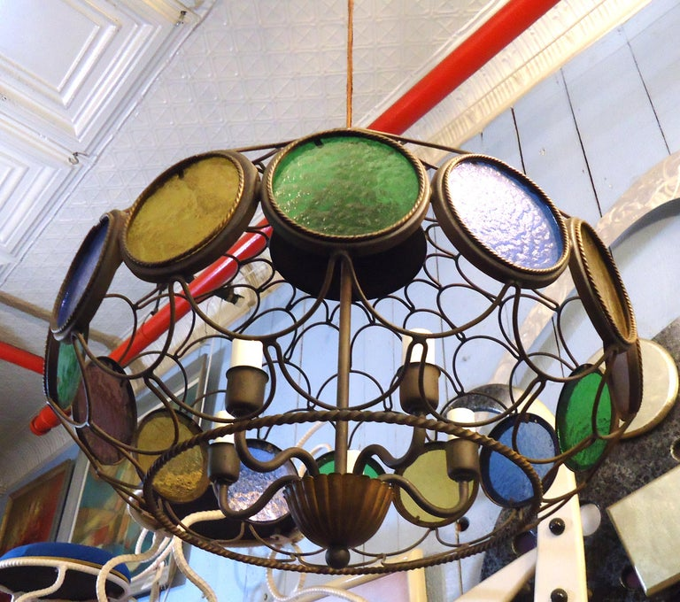 Mid-Century Modern Italian style chandelier features stained glass accents within a metal oval framed dome. (Please confirm item location - NY or NJ - with dealer).