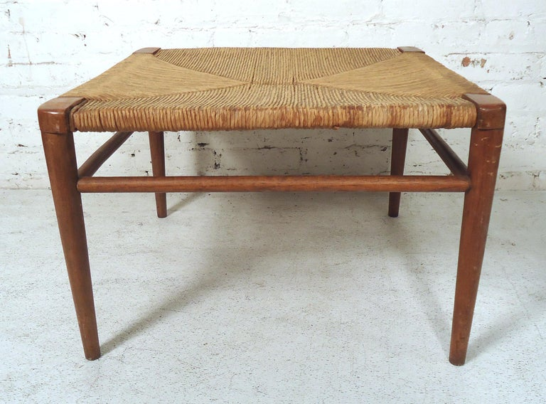Beautiful Mid-Century Modern woven rope bench featured on rich teak grain tapered legs.  (Please confirm item location-NY or NJ-with dealer).