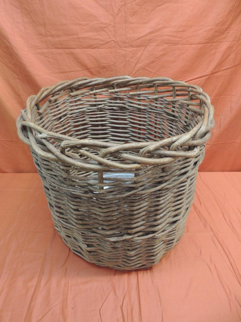 Vintage monumental round willow planter/basket. Oversized woven basket, idale for large trees or to hold fireplace wood logs. Includes plastic liner. Size: 22