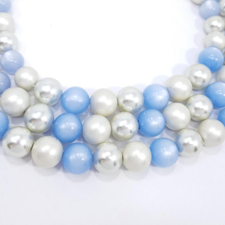 Matching necklace and earrings set, featuring an extravagant triple-strand necklace and clip on earrings in a vintage gold-tone finish. Decorated with faux pearls and moon-glow beads in white & blue.  Clip on earrings, diameter - 1 inch Necklace,
