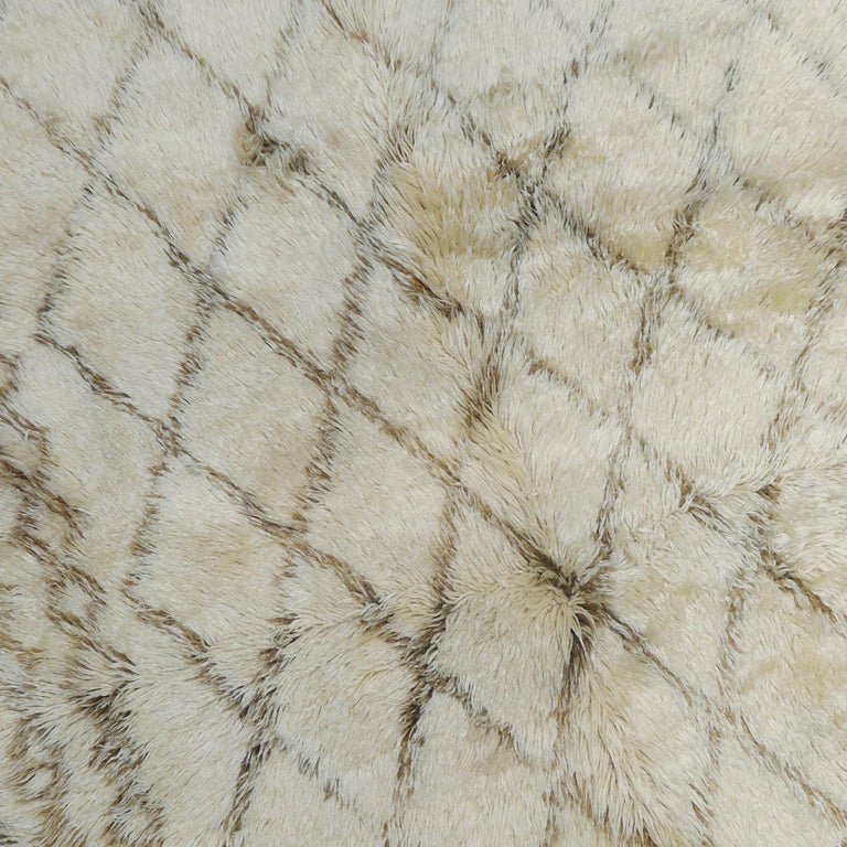 Hand-Knotted Vintage Moroccan Berber Rug with a Natural Ivory Wool and Olive Color Accent For Sale