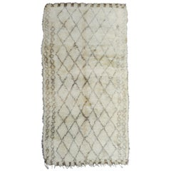 Vintage Moroccan Berber Rug with a Natural Ivory Wool and Olive Color Accent