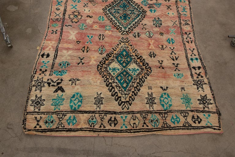 Boujad is a large widespread area and not a tribe. Since they are woven by a number of tribes so they can display varying techniques and styles. Originating in the middle atlas region of Morocco, Boujad rugs are low-pile soft wool and known for