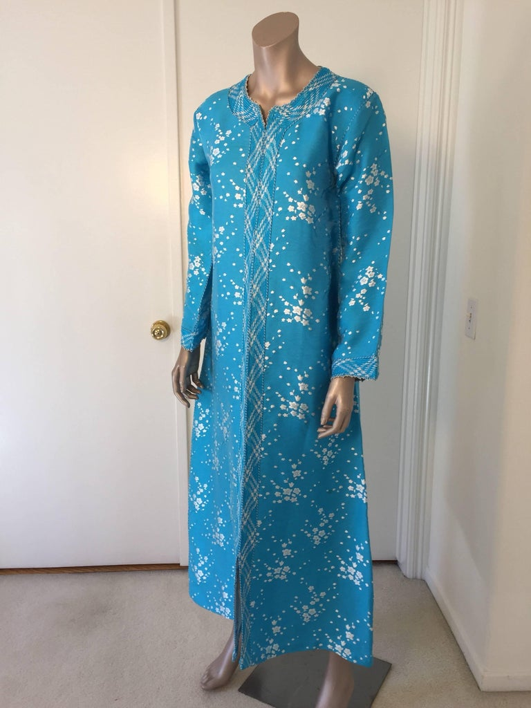 Elegant vintage designer Moroccan turquoise blue kaftan, embroidered with turquoise and white trim. This chic Gypsy Bohemian maxi dress kaftan is embroidered and embellished with a blue and white trim.  One of a kind evening Moroccan Middle Eastern
