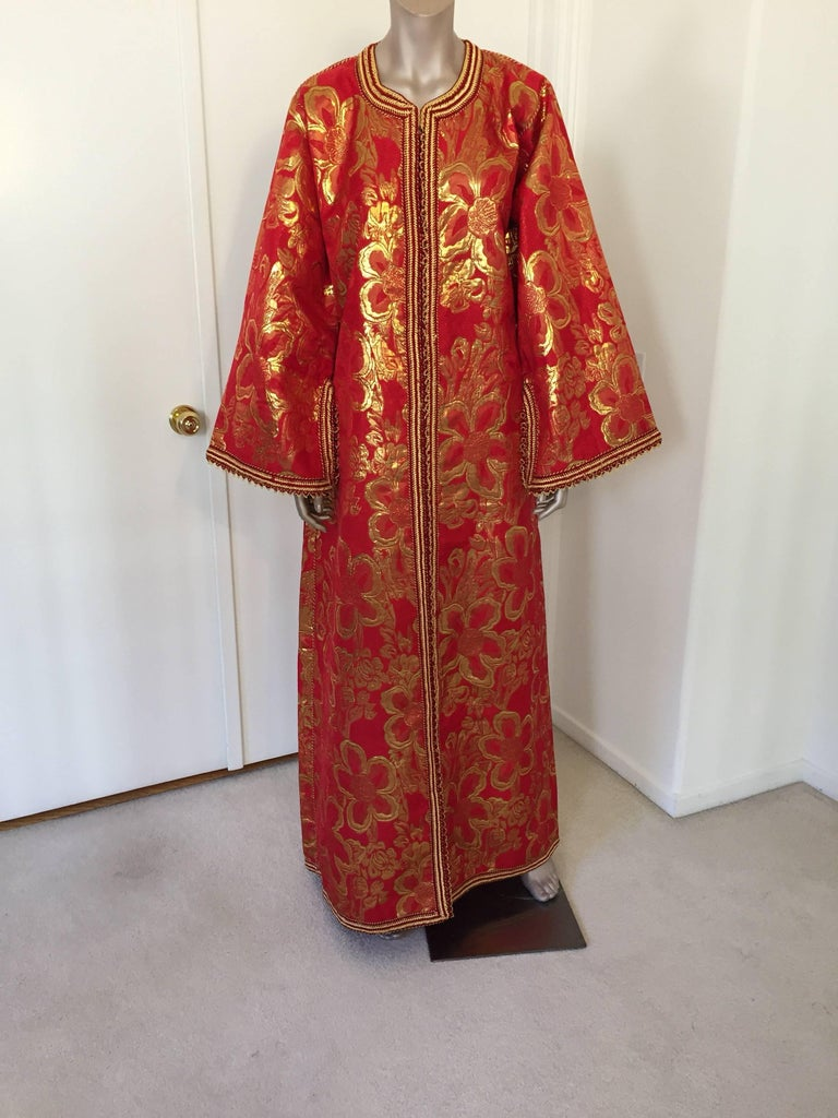 Metallic red and gold brocade maxi dress kaftan hand made by Moroccan artist.  Handmade vintage exotic 1970s gold and red metallic brocade ceremonial caftan gown from North Africa, Morocco.  The luminous brocade fabric shimmers with allover golden