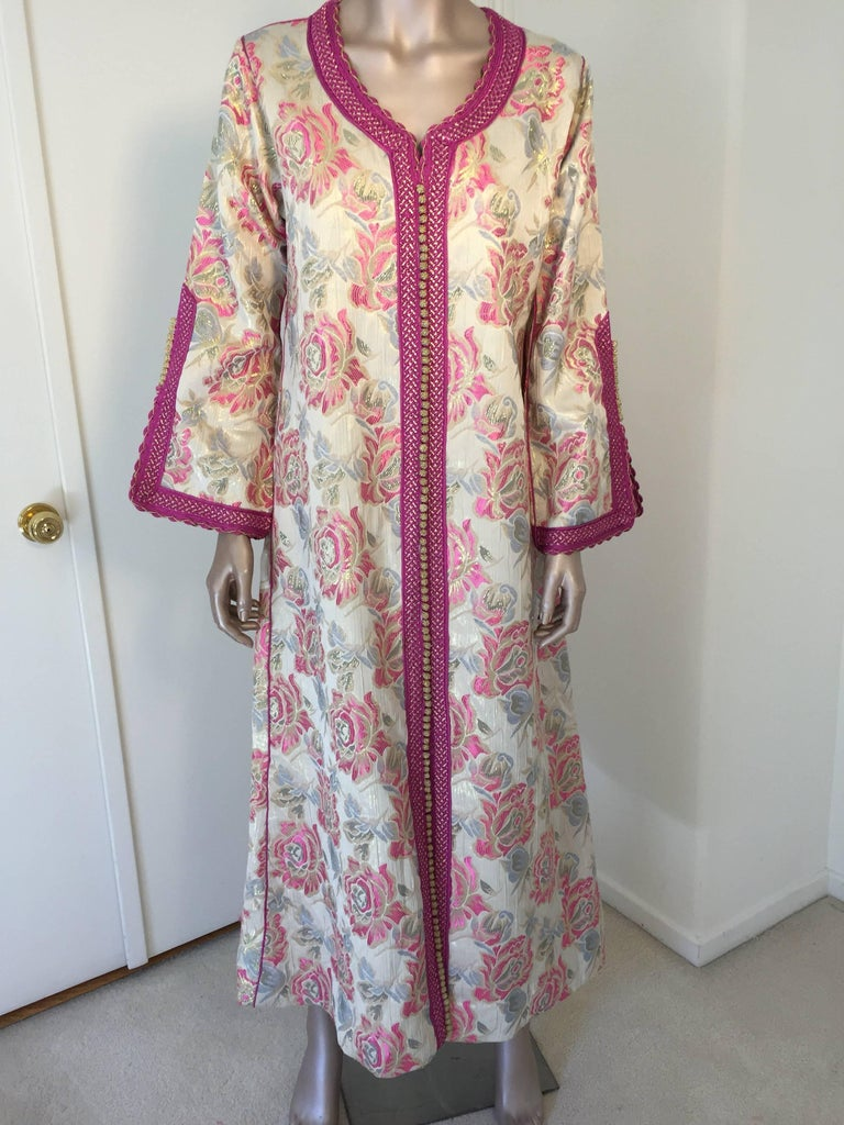 Elegant vintage designer Moroccan kaftan, floral brocade embroidered with hot pink and gold trim.