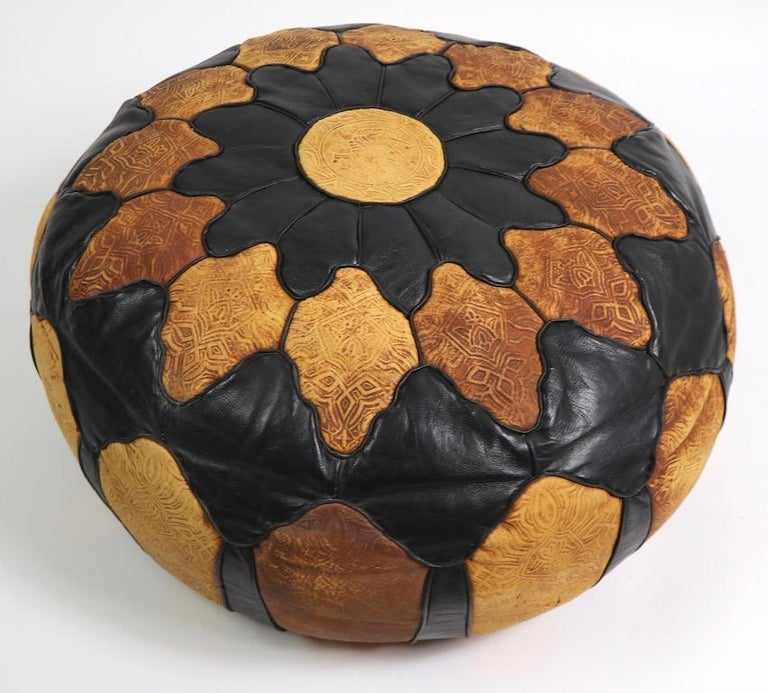 Nice vintage Moroccan pouf of pieced leathern and suede, with tooled decoration. Good original condition one very slight opening in one seam, pictured. Clean and ready to use.