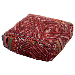 Vintage Moroccan pouf made from a Zemmour rug by Berber Tribe