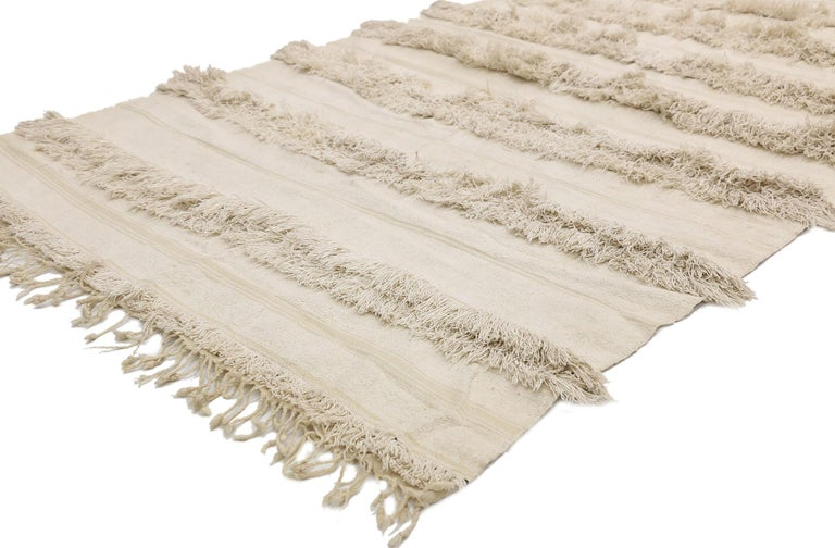 20820, vintage Moroccan wedding blanket, Berber Handira Tamizart. This handwoven wool vintage Moroccan wedding blanket also known as a Berber Handira features rows of fluffy fringe. The underside of this vintage Handira blanket displays kilim bands
