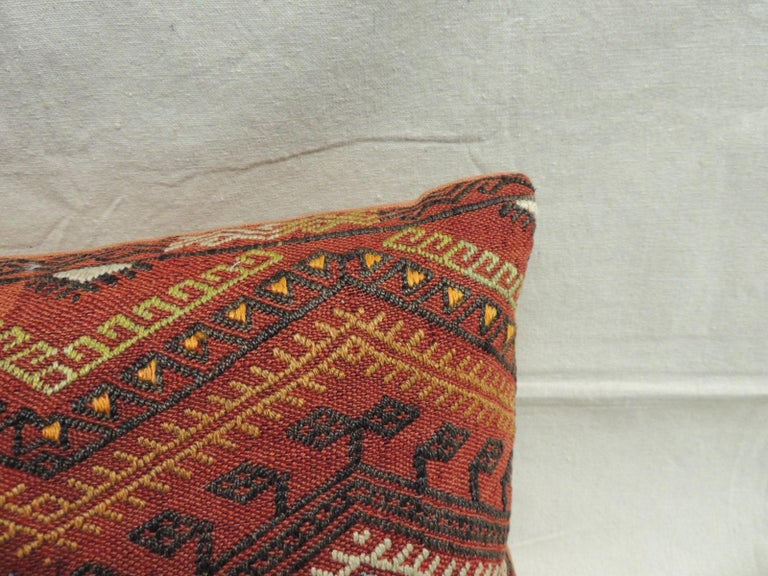 Vintage Moroccan woven orange and red Kilim decorative Bolster pillow.