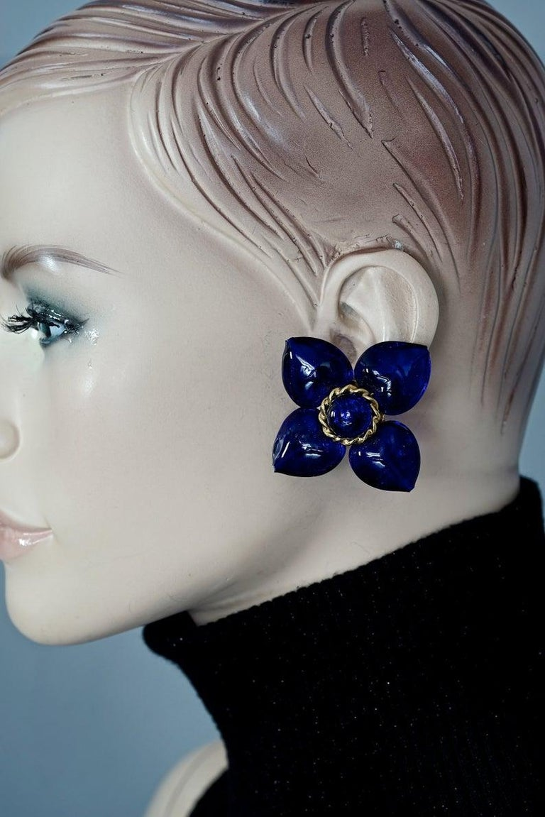 Vintage MOSCHINO Blue Glass Flower Earrings  Measurements: Height: 2.08 inches (5.3 cm) Width: 2.16 inches (5.5 cm) Weight per Earring: 27 grams  Features: - 100% Authentic MOSCHINO. - Massive Blue glass flower earrings. - Gold tone hardware. -