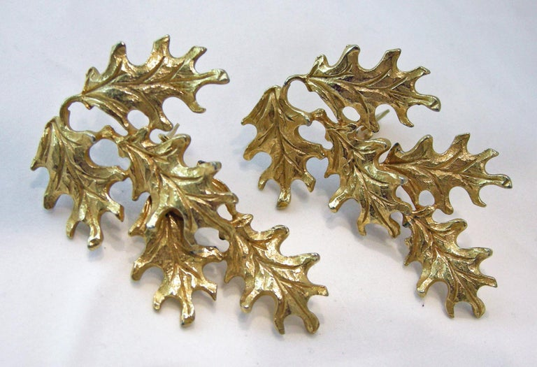 """These vintage signed Mosell earrings actually dangle with decorative leaf design in a gold tone setting. The earrings measures 2-1/2"""" x 1-1/2"""" and is signed """"Mosell"""".  They are in excellent condition."""