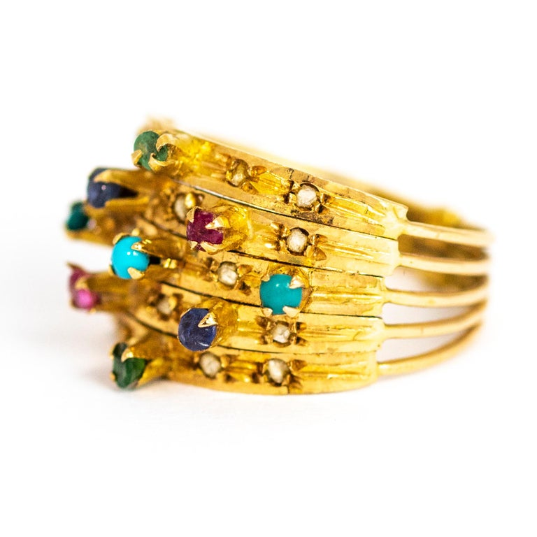 This stylish ring holds Turquoise, Sapphire, Ruby, Emerald and diamonds. The diamond points sit flush in the extra wide band.   Ring Size: P 1/2 7 3/4 Band Width: 12.5mm