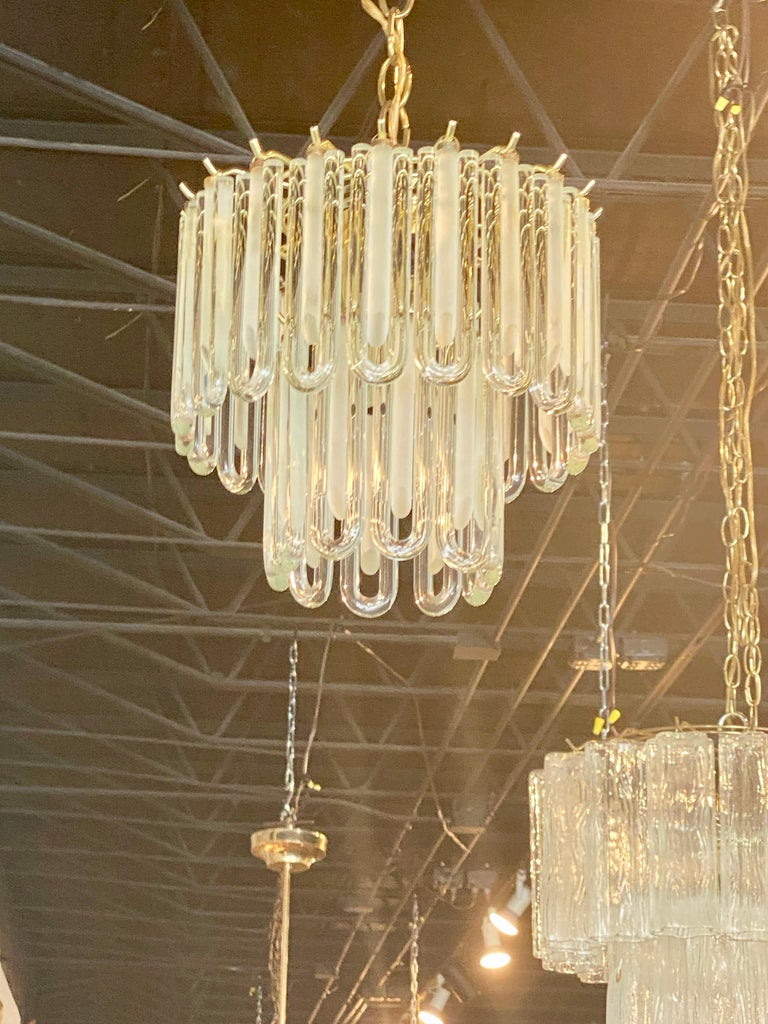 Lovely vintage Murano glass chandelier. Perfect size for a powder room, bathroom, closet, hall, etc. Brass cage. No broken pieces of glass. Comes with original ceiling canopy. Height below is for chandelier only, not chain.