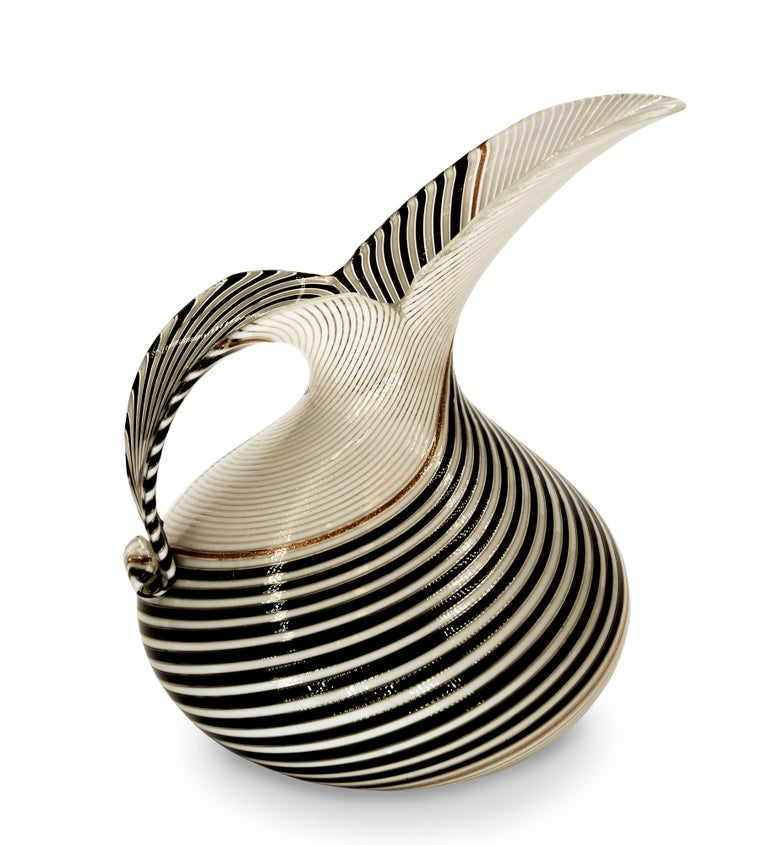 This Pitcher for Aureliano Toso, realized in blown a canne glass in 1950s, is designed by Dino Martes (1894-1970).  In excellent conditions, with an elegant shape and strong contrasting colors.  This object is shipped from Italy. Under existing