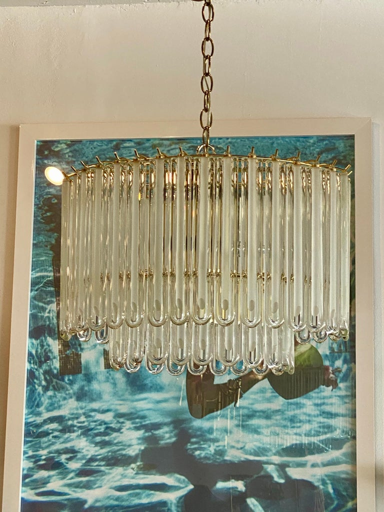 Vintage Murano glass chandelier with brass cage. No broken or chipped pieces of glass. Comes with original brass ceiling canopy.