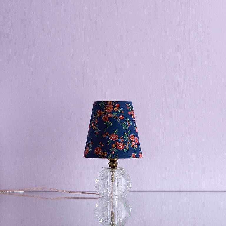 Italy, 1950s  Table lamp in clear glass with customised shade  A pair is available.  Measures: H 25 x Ø 15.
