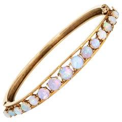 Vintage Natural Opal Bracelet 14 Karat Yellow Gold Bangle Estate Jewelry